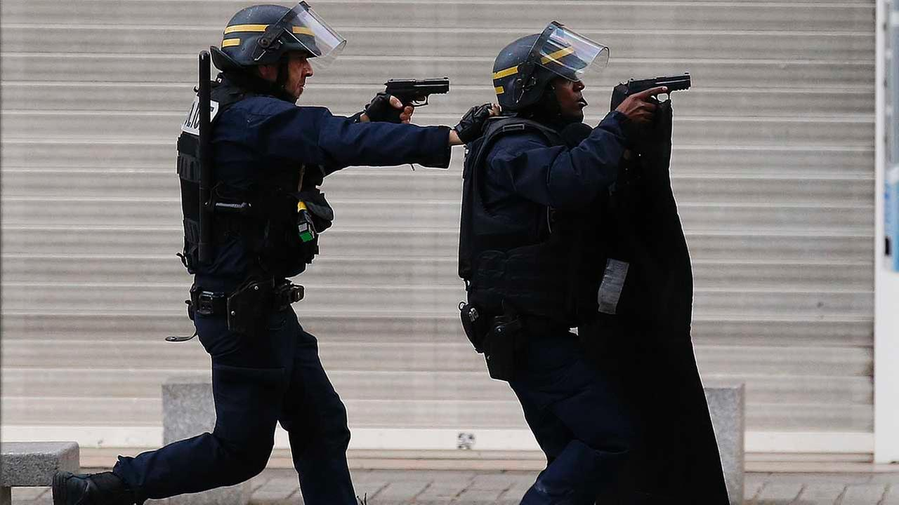 Armed police operate in Saint-Denis, a northern suburb of Paris, Wednesday, Nov. 18, 2015.