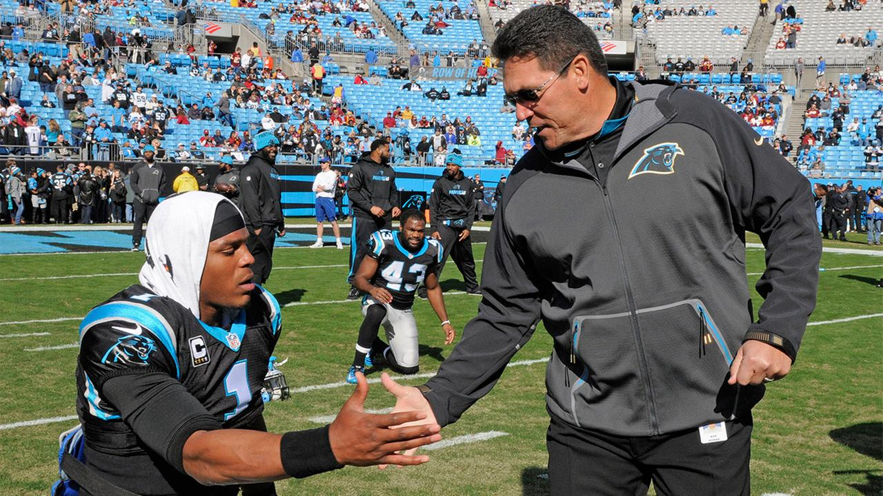 Carolina Panthers head coach Ron Rivera, right, shakes hands with Cam Newton, left, before Sundays game against the Washington Redskins.