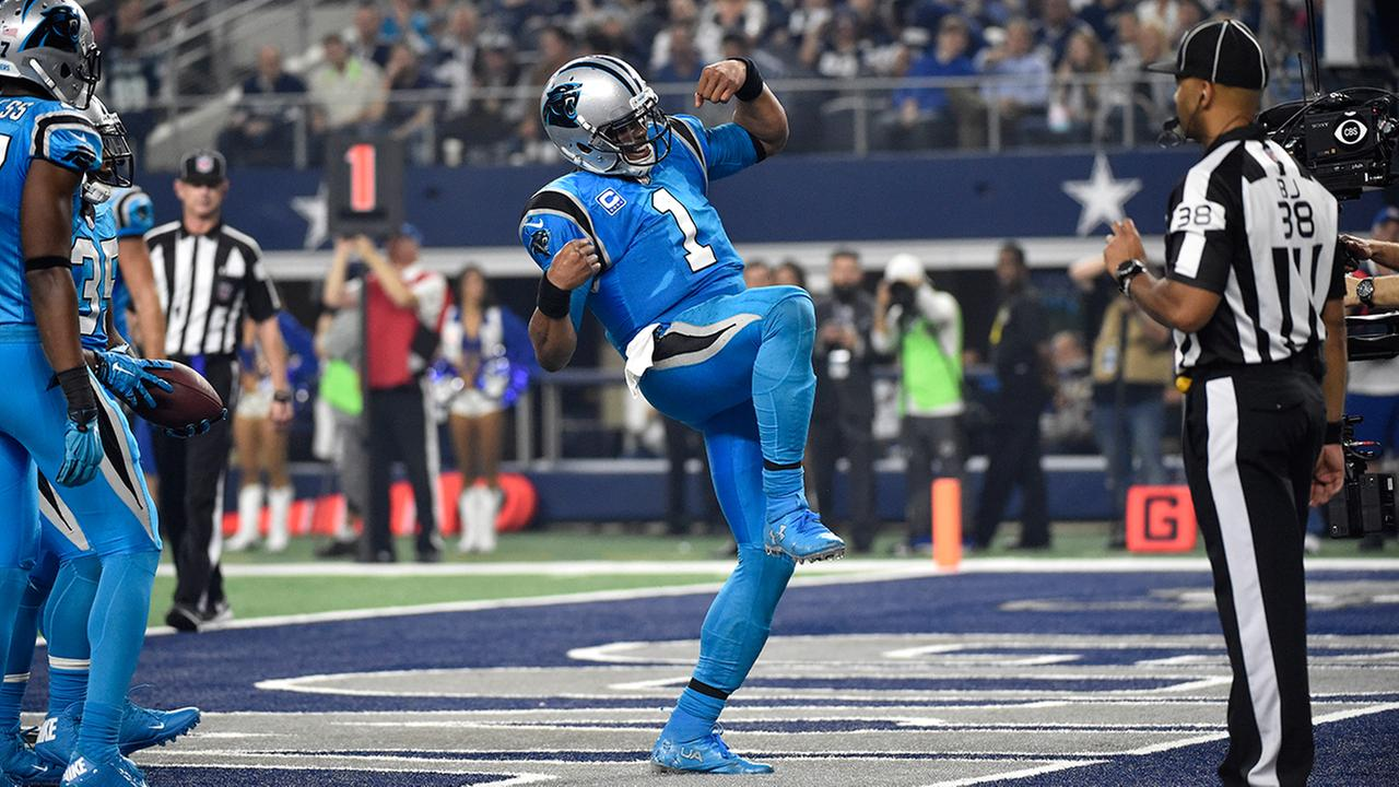 Carolina Panthers Cam Newton (1) celebrates after rushing for a touchdown against the Dallas Cowboys in an NFL football game, Thursday, Nov. 26, 2015, in Arlington, Texas.