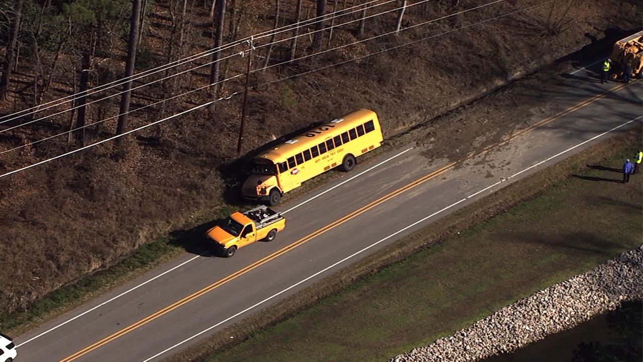A school bus slid into a ditch on Forestville Road