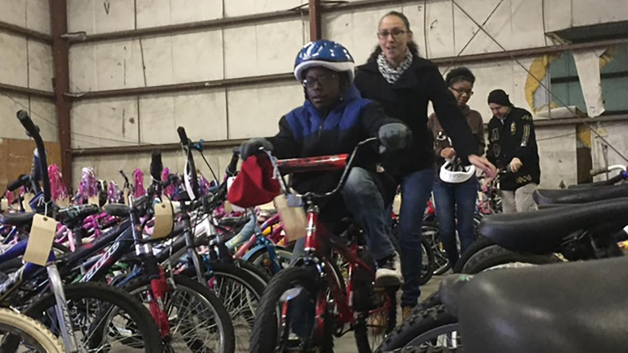 Christmas came early for dozens of kids in Fayetteville