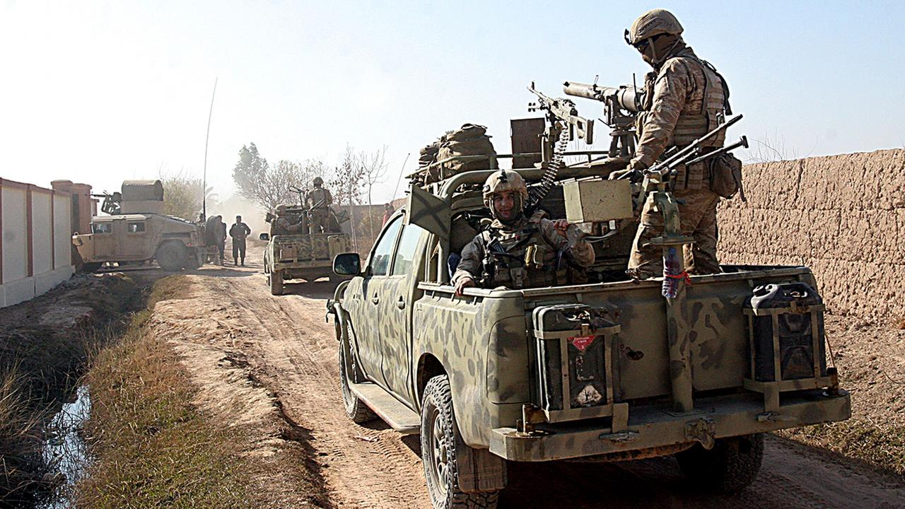 Afghan security forces patrol in Nad Ali district of Helmand province, Afghanistan, Tuesday.