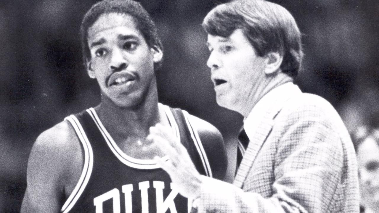Coach Bill Foster gives instruction to Duke guard Vince Taylor.