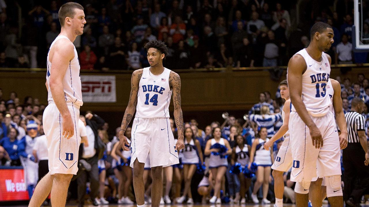 Dukes Marshall Plumlee, left, Brandon Ingram, Grayson Allen, second from right, and Matt Jones walk off the court following an NCAA college basketball game against Syracuse