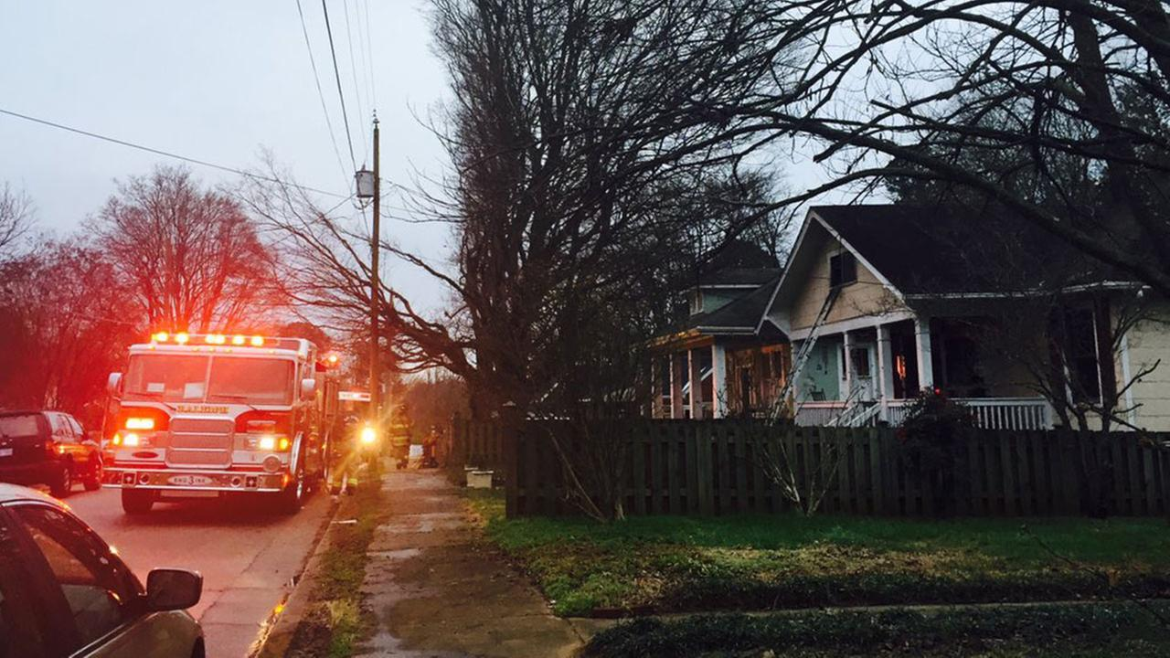 Firefighters at the scene of a house fire on Hanover and Aycock streets Wednesday morning.