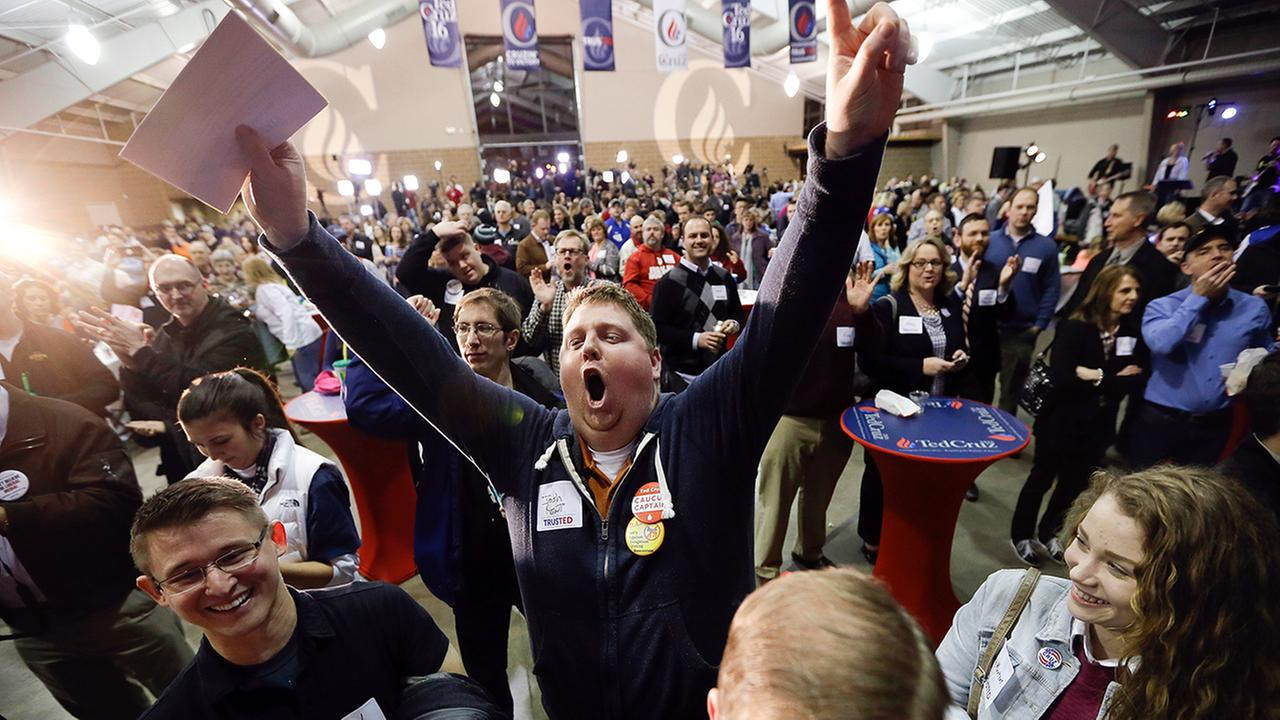 Josh Kent celebrates at Republican presidential candidate, Sen. Ted Cruz, R-Texas, caucus night rally, Monday, Feb. 1, 2016, in Des Moines, Iowa.