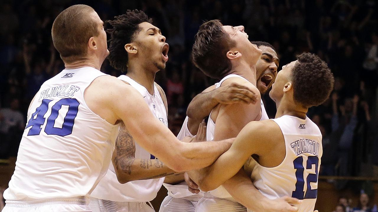 Dukes Grayson Allen, center, is congratulated by Marshall Plumlee, Brandon Ingram, Matt Jones, second from right, and Derryck Thornton following Allens game winning shot