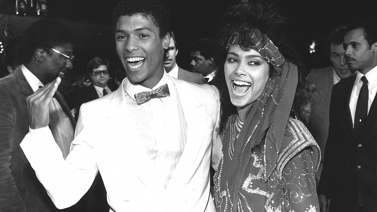 In this March 22, 1985 photo, actor Taimak, left, and Vanity arrive at the Century Plitt Theater for the premiere of their film The Last Dragon.