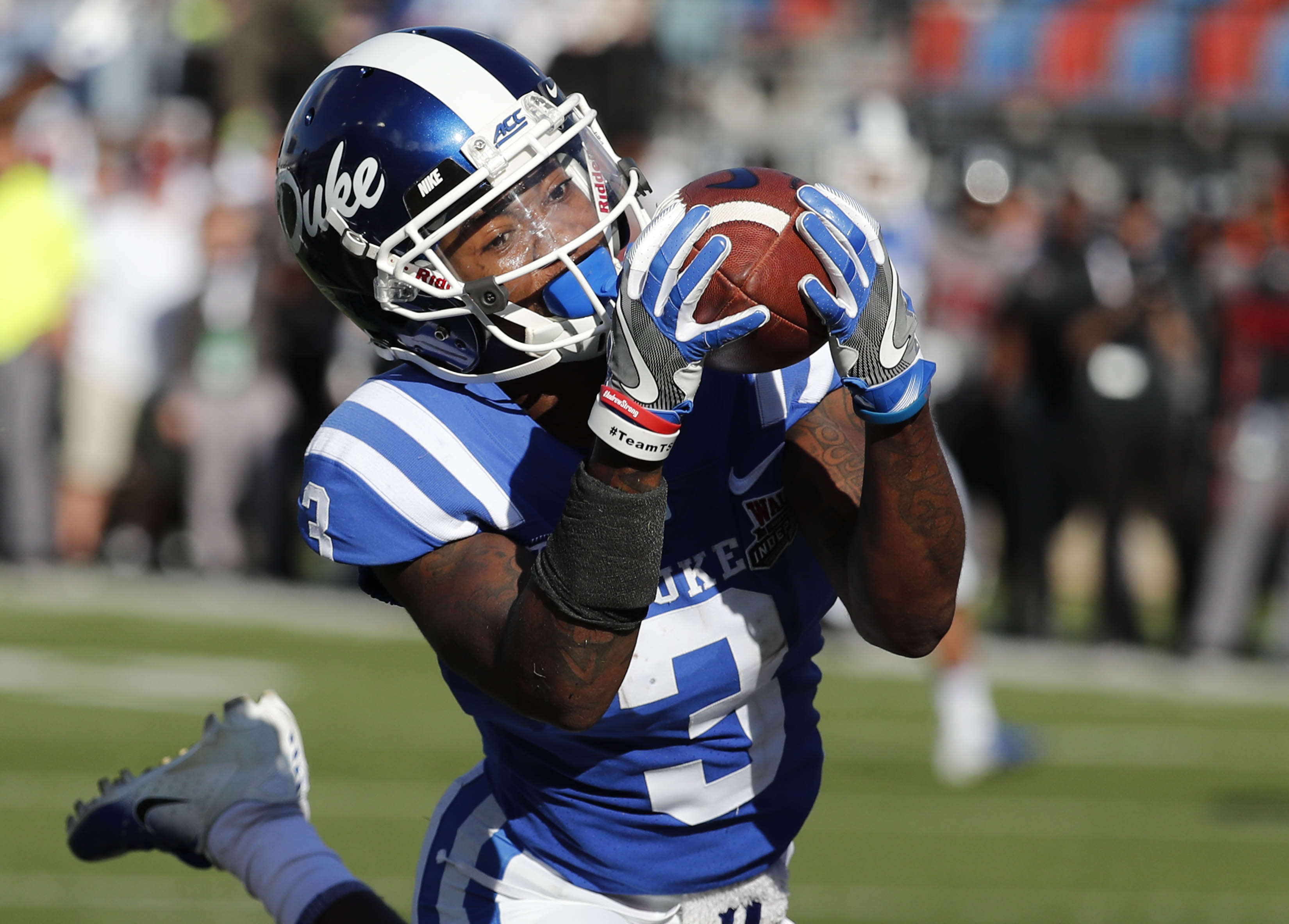 Duke wide receiver T.J. Rahming (3) hauls in a touchdown pass reception against Temple during the first half of the Independence Bowl,