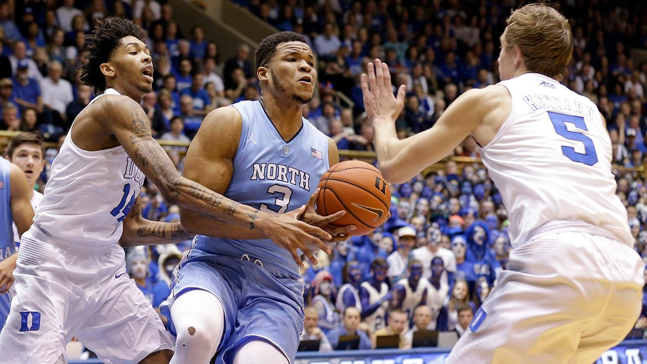 North Carolinas Kennedy Meeks (3) is pressured by Dukes Brandon Ingram, left, and Luke Kennard (5) during the first half of an NCAA college basketball game in Durham
