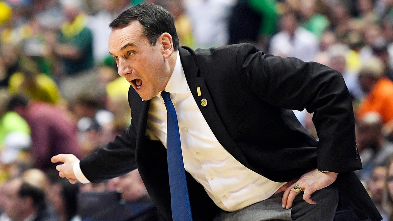 Duke head coach Mike Krzyzewski yells to his team during the first half of a 2016 NCAA college basketball game against Oregon in the regional semifinals of the NCAA Tournament.