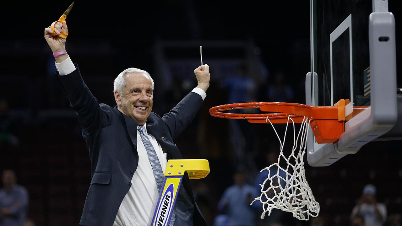 North Carolina head coach Roy Williams reacts after cutting the net after a regional final mens college basketball game against Notre Dame in the NCAA Tournament