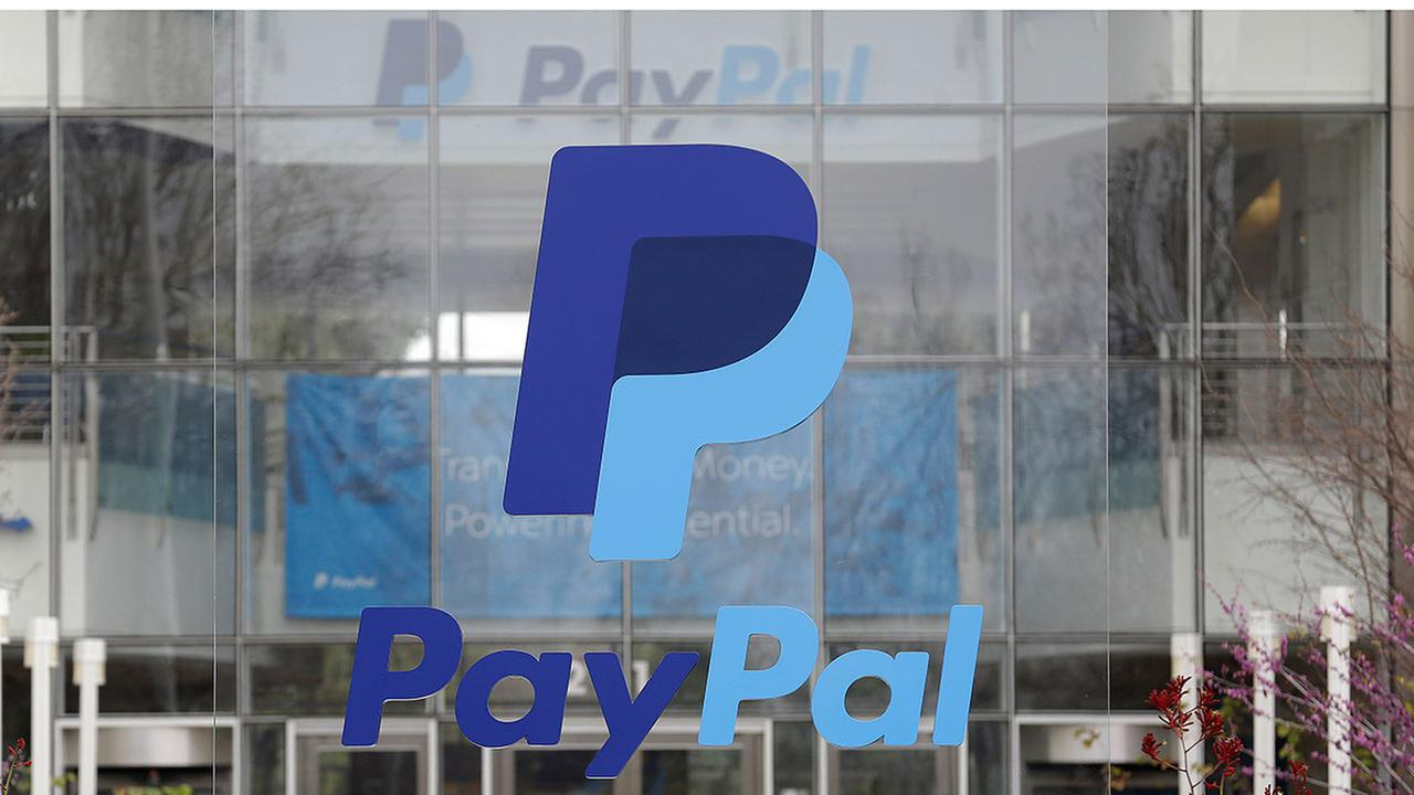 PayPal sign outside of the main entrance to an office building in San Jose, Calif.
