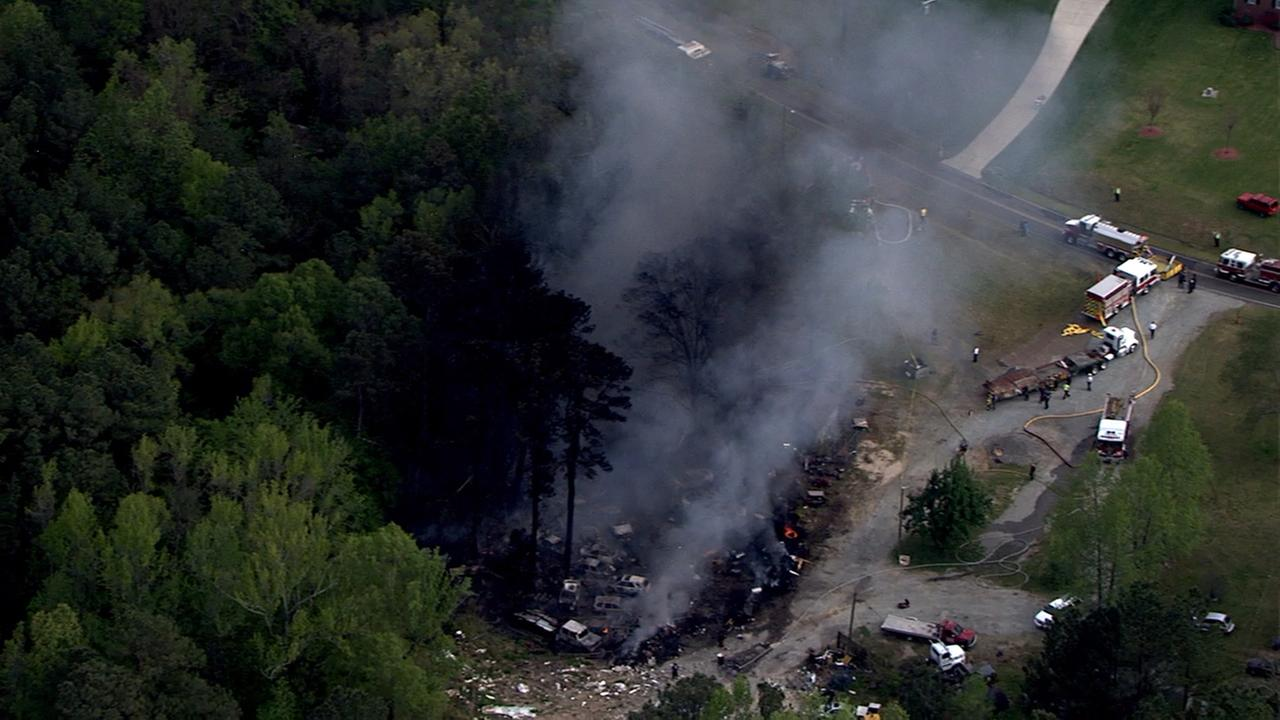 Firefighters battle a large fire at a salvage yard on Jeffries Road in northern Durham County.