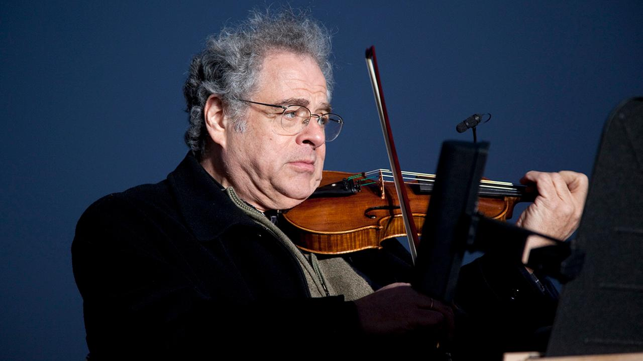 In this Wednesday, Dec. 10, 2010 file photo, Itzhak Perlman plays the violin during the National Menorah lighting in celebration of Hanukkah near the White House in Washington.