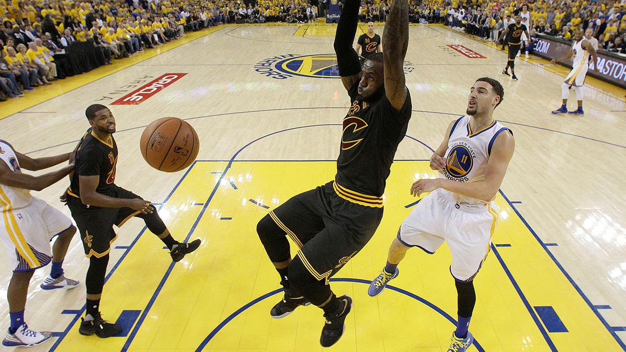 Cleveland Cavaliers forward LeBron James dunks against Golden State Warriors guard Klay Thompson (11) during the first half of Game 7 of basketballs NBA Finals in Oakland