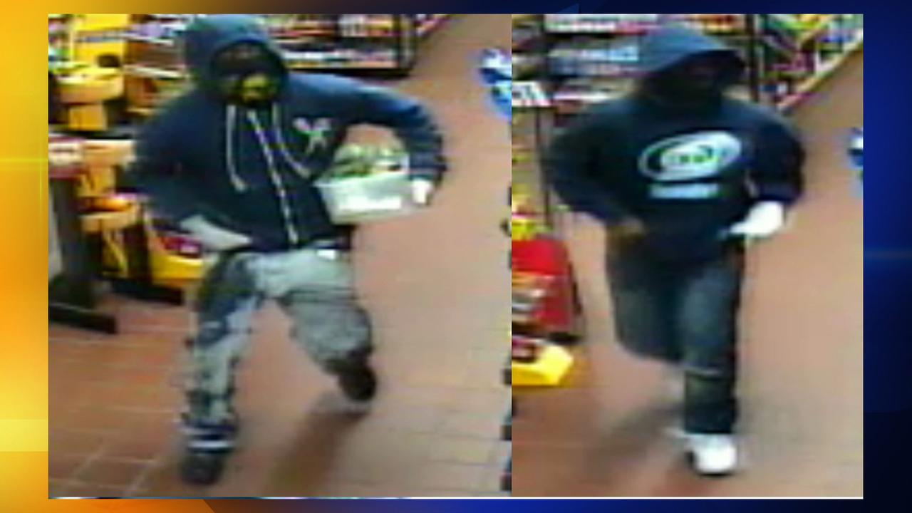 Surveillance photos of the suspects in a C-Mart armed robbery