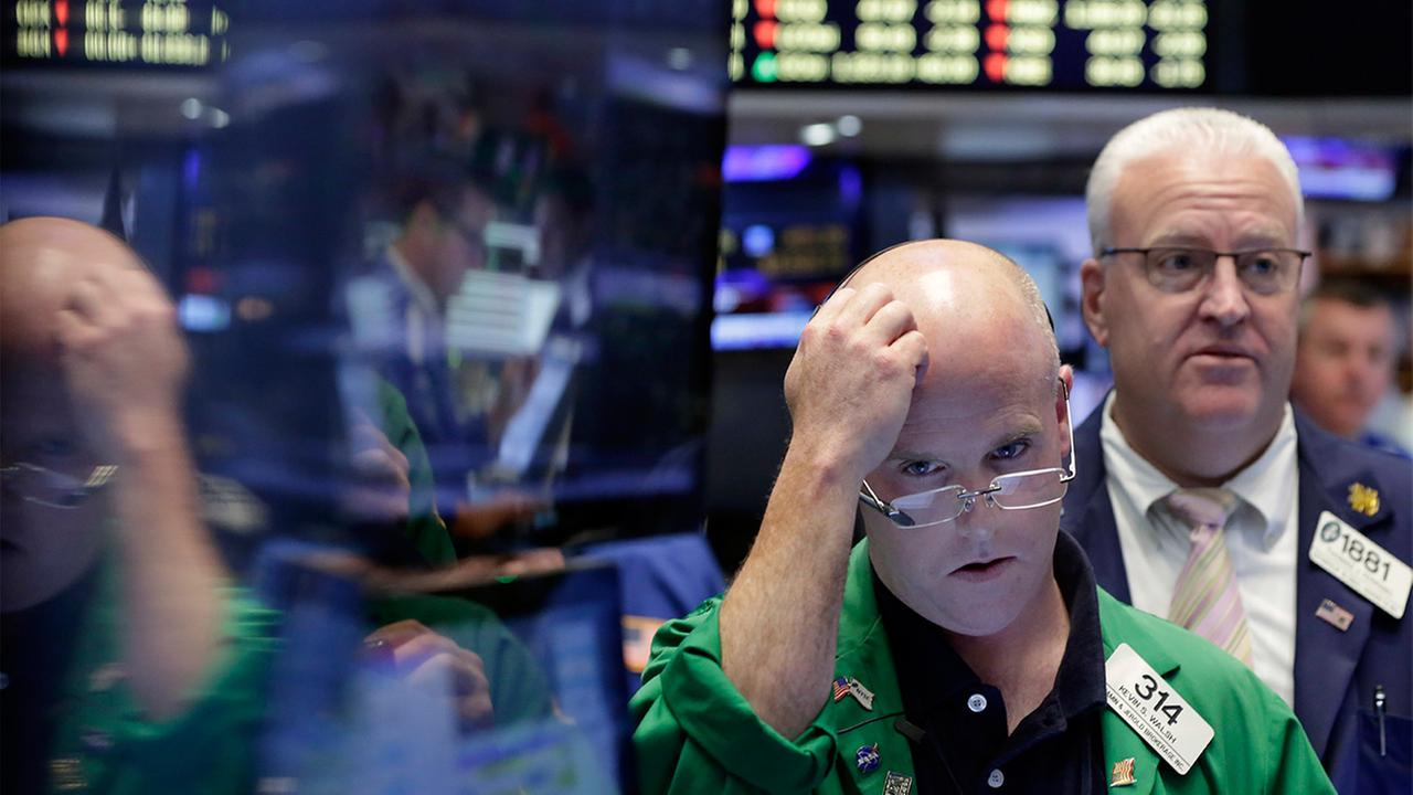 Trader Kevin Walsh, second from right, works on the floor of the New York Stock Exchange, Friday, June 24, 2016.