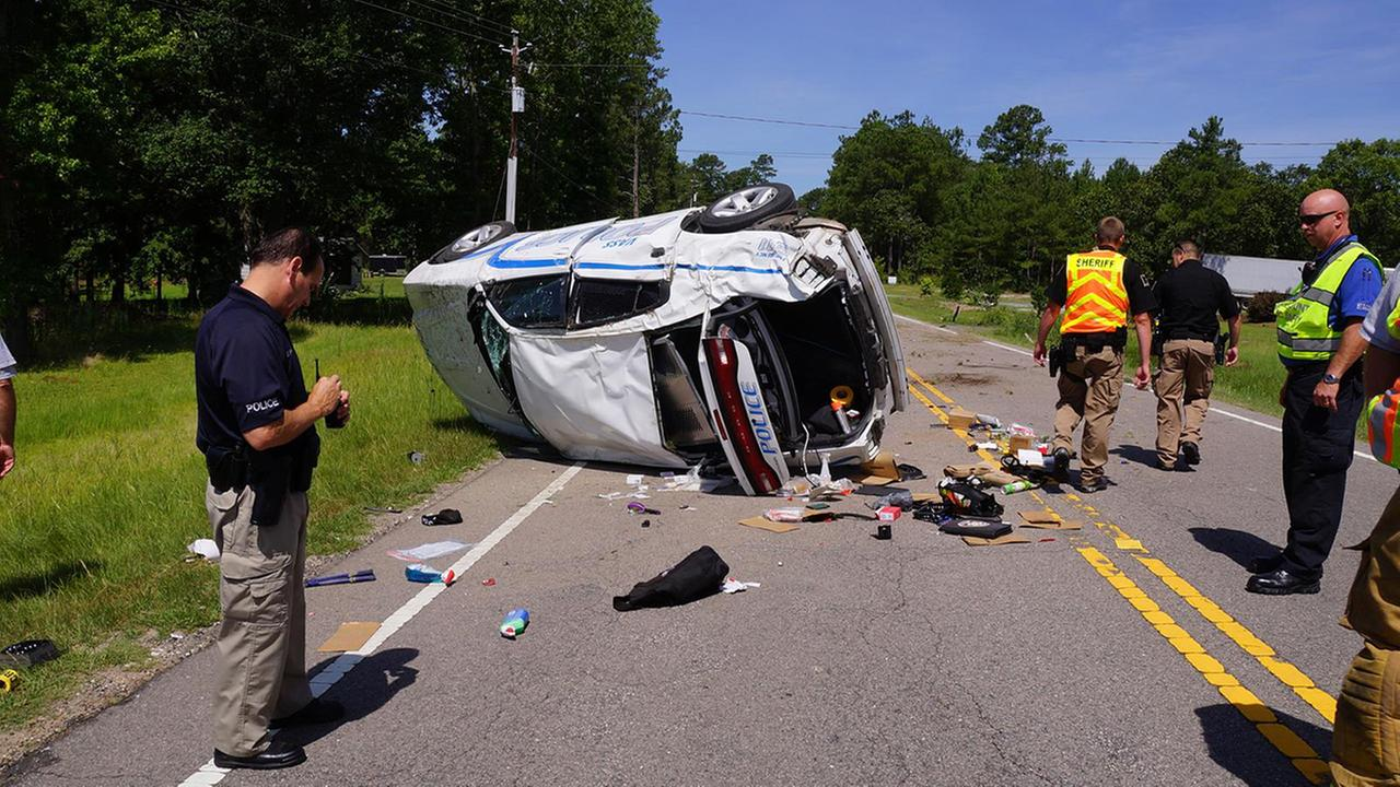 The police cruiser flipped at least twice