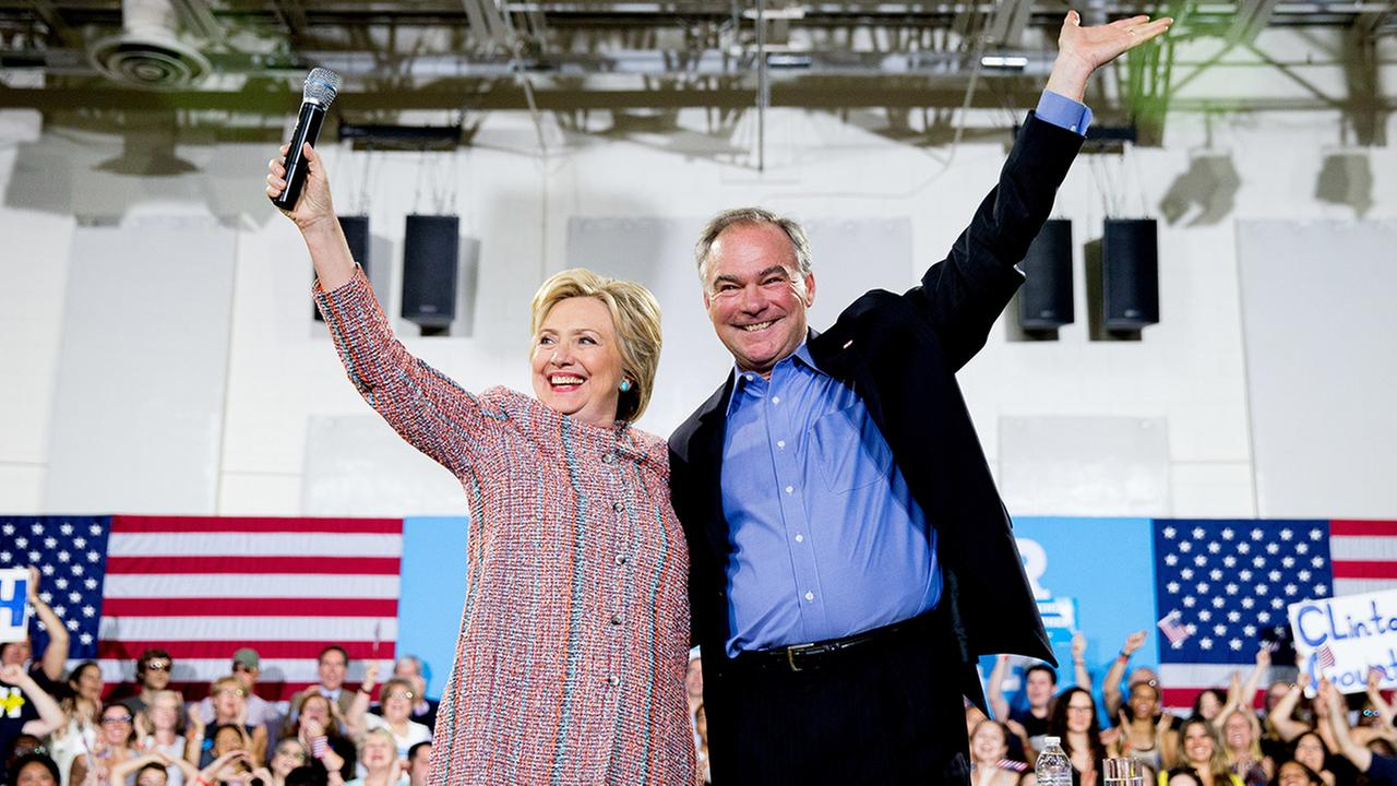 In this July 14, 2016, file photo, Democratic presidential candidate Hillary Clinton, accompanied by Sen. Tim Kaine, D-Va., speaks at a rally.
