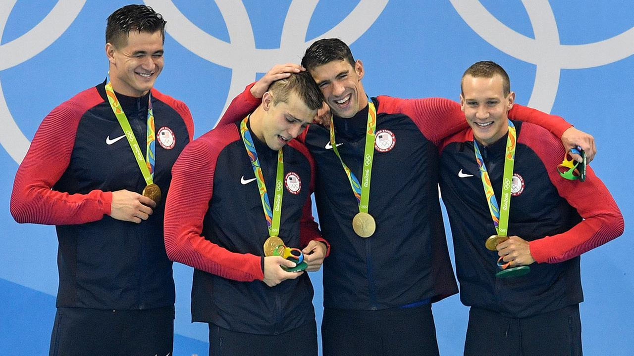 From right United States Caeleb Dressel, Michael Phelps, Ryan Held, and Nathan Adrian, celebrate after winning gold in the mens 4 x 100-meter freestyle relay