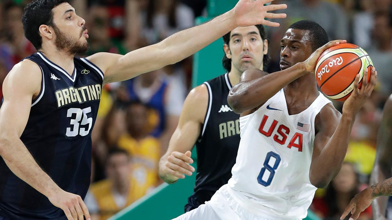 United States Harrison Barnes (8) grabs a rebound over Argentinas Roberto Acuna (35) during a quarterfinal round basketball game at the 2016 Summer Olympics in Rio de Janeiro