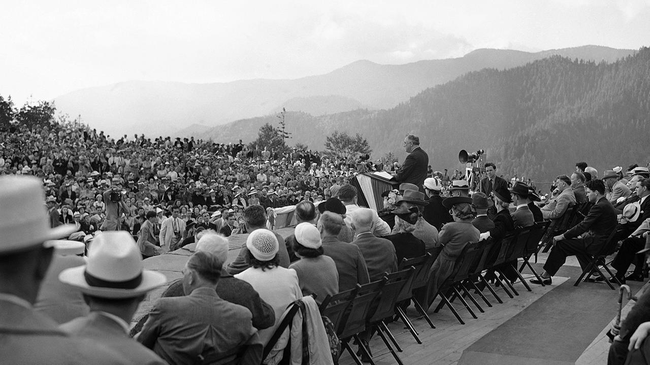President Franklin D. Roosevelt is standing before a crowd in Newfound Gap on the Tennessee-North Carolina border on Sept. 2, 1940 as he dedicated the GSMNP.