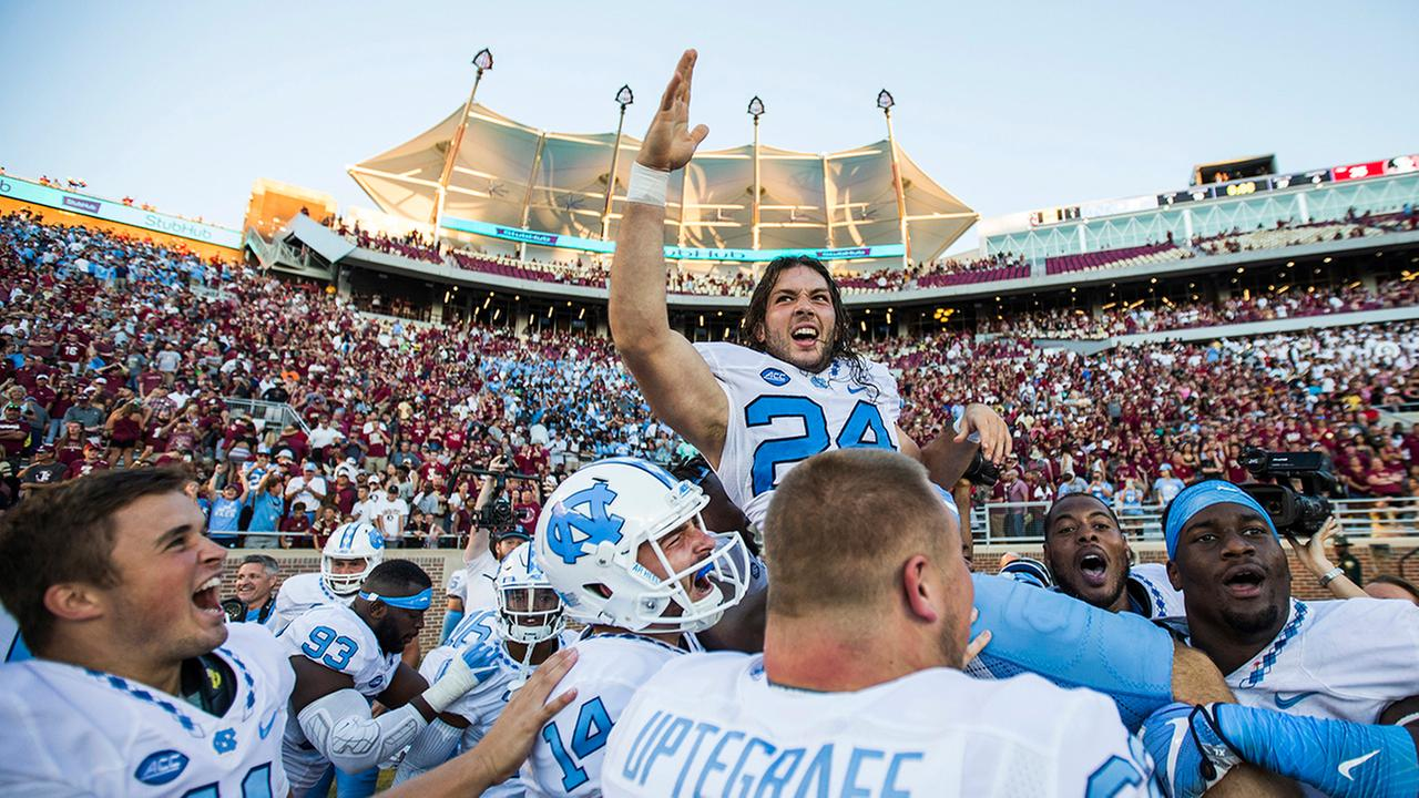Players from North Carolina hoist kicker Nick Weiler on their shoulders after Weiler kicked the game winning 54-yard field goal against Florida State