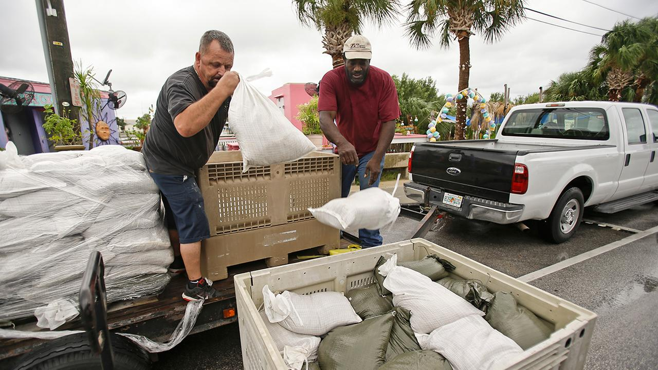 Sandbags bags are unloaded as residents prepare for Tropical Storm Hermine, Wednesday, Aug. 31, 2016, in Cedar Key, Fla.
