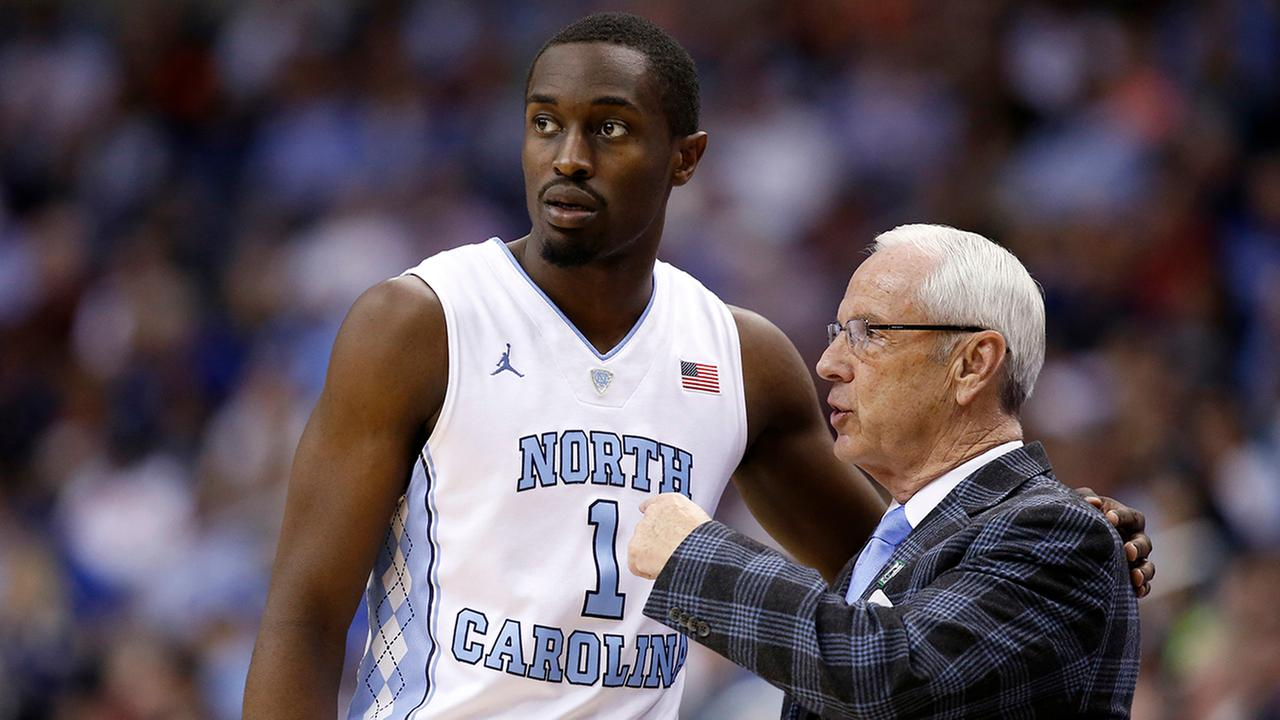 North Carolina forward Theo Pinson (1) talks with North Carolina head coach Roy Williams during the second half of an NCAA college basketball game