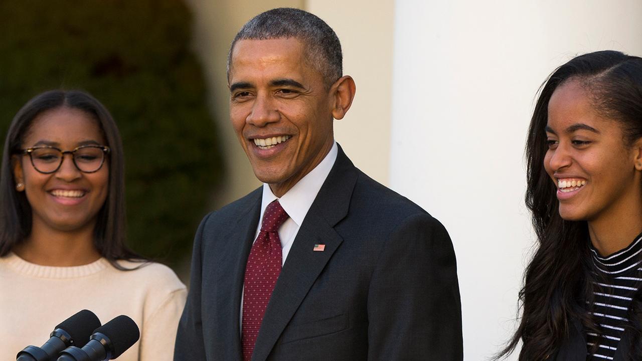 Sasha Obama, left, and Malia Obama, right, look on as their dad President Barack Obama makes a joke on Wednesday, Nov. 25, 2015, in Washington.