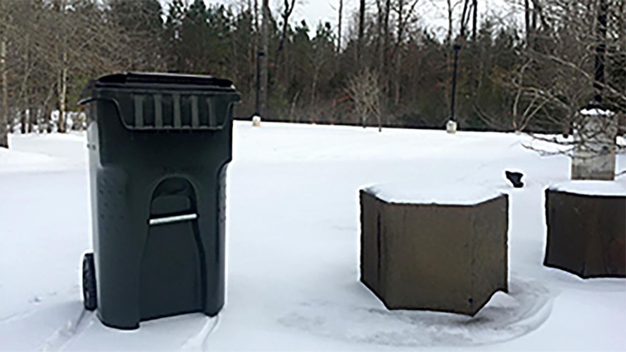 Garbage cans in the snow in Chapel Hill