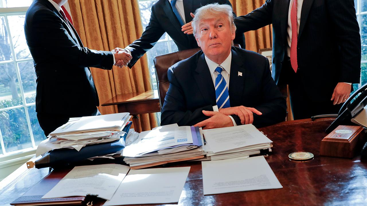 President Donald Trump sits at his desk after a meeting, Wednesday, Feb. 8, 2017.