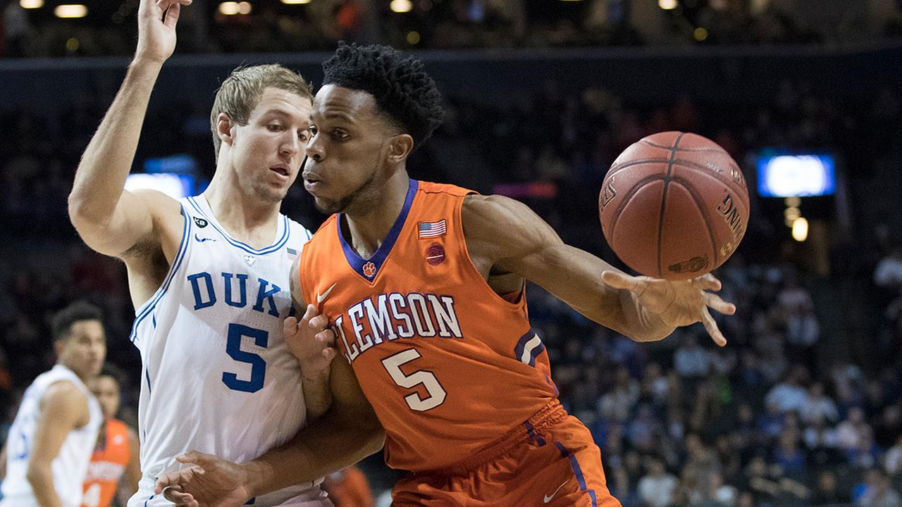 Dukes Luke Kennard, left, guards Clemson forward Jaron Blossomgame on Wednesday at the ACC Tournament.