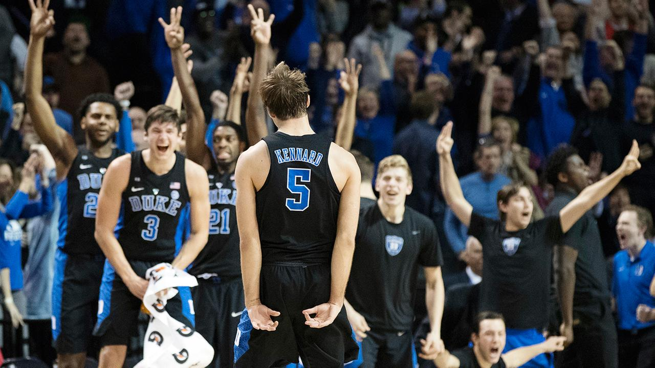 Duke guard Luke Kennard (5) celebrates with his teammates after tying the game during the final minutes of the second half of an NCAA college basketball game against Louisville.