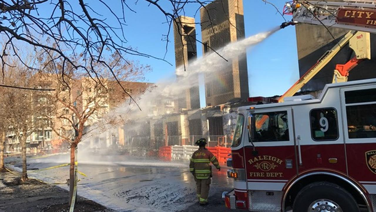 Firefighters put water on hotspots the day after the fire (WTVD photo/Jeff Hinkle)