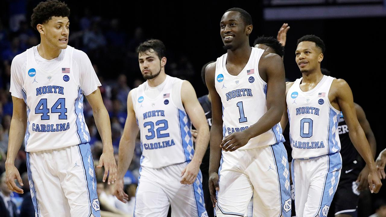 North Carolina players walk down the court in the closing moments of the second half of an NCAA college basketball tournament South Regional semifinal game against Butler, Friday, March 24, 2017, in Memphis, Tenn. North Carolina won 92-80.