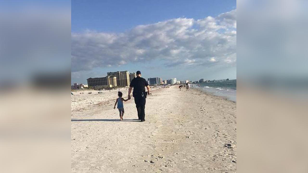 A Clearwater Beach officer helped this little girl reunite with her family