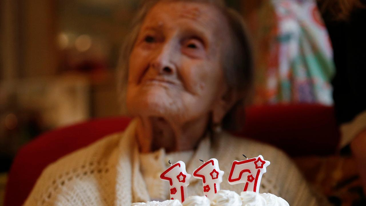 Emma Morano is pictured behind a cake with candles marking 117 years in the day of her birthday in Verbania, Italy, Tuesday, Nov. 29, 2016.