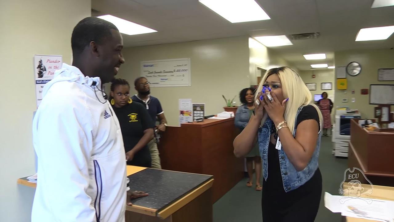 ECU football coach surprised a players mother with a full scholarship