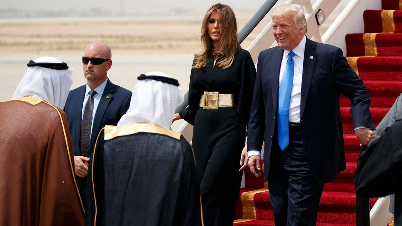 U.S. President Donald Trump, accompanied by first lady Melania Trump, smiles at Saudi King Salman, left, upon his arrival at a welcome ceremony at the Royal Terminal of King Khalid International Airport, Saturday, May 20, 2017, in Riyadh.