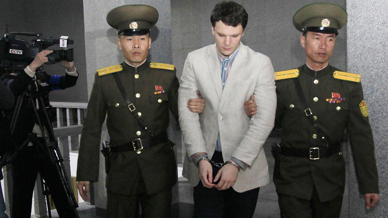 American student Otto Warmbier, center, is escorted at the Supreme Court in Pyongyang, North Korea, Wednesday, March 16, 2016.