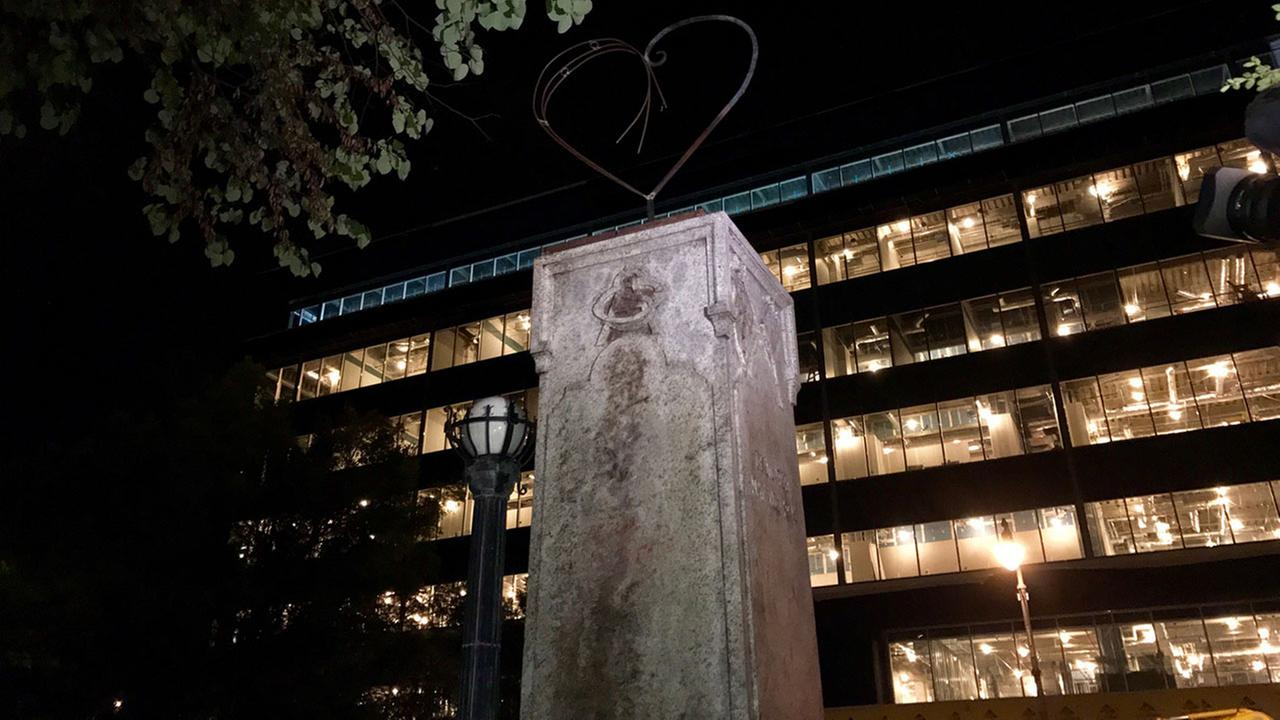 A heart, made of metal, was added overnight to the pedestal that was for the now crumpled Confederate statue outside the old courthouse on East Main Street in downtown Durham.