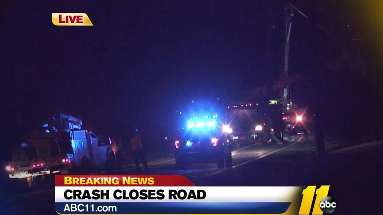 Crash knocks out power to hundreds, closes Raleigh road
