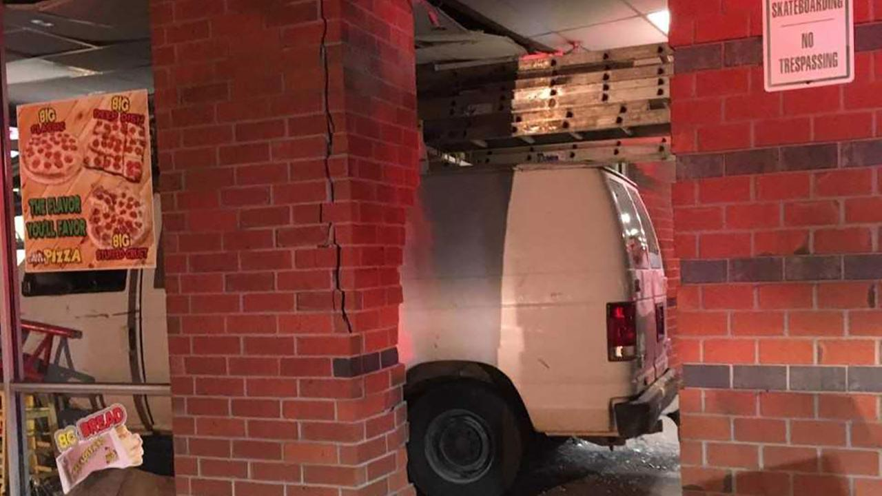Van drives into a pizza business.