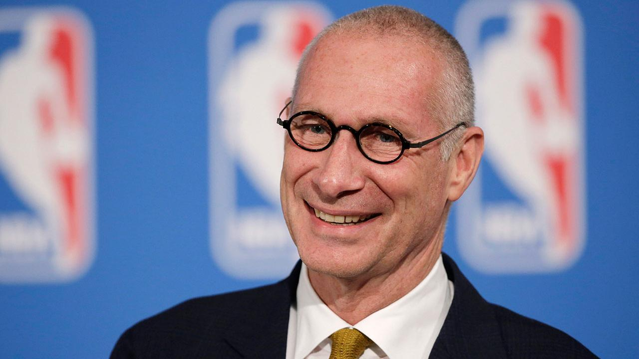 In this Oct. 6, 2014, file photo, ESPN President John Skipper smiles during a news conference in New York.