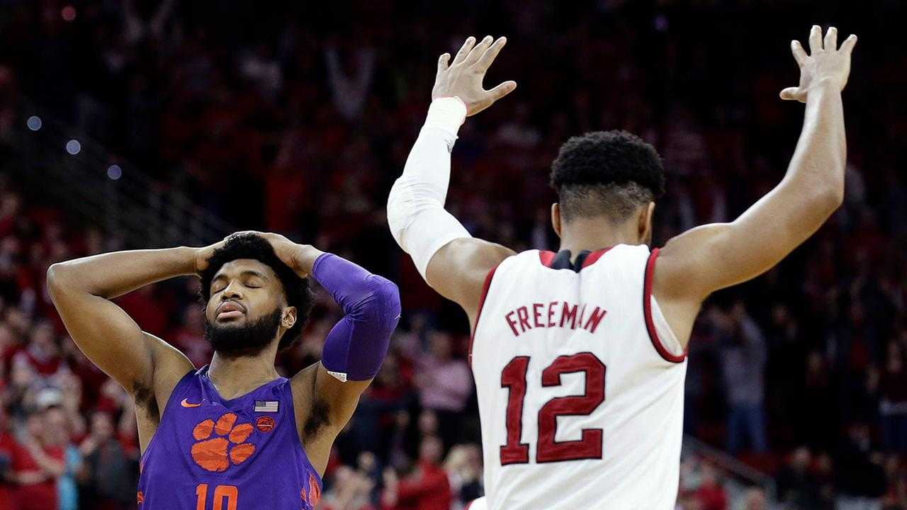Clemsons Gabe DeVoe reacts after missing a free throw that would have tied the game with less than a second to play as NC States Allerik Freeman celebrates Thursday night in Raleigh.