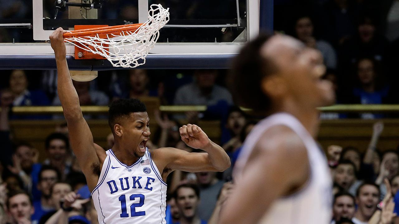 Dukes Javin DeLaurier (12) and Wendell Carter Jr. react as Duke pulls away Wednesday from Virginia Tech in Durham.