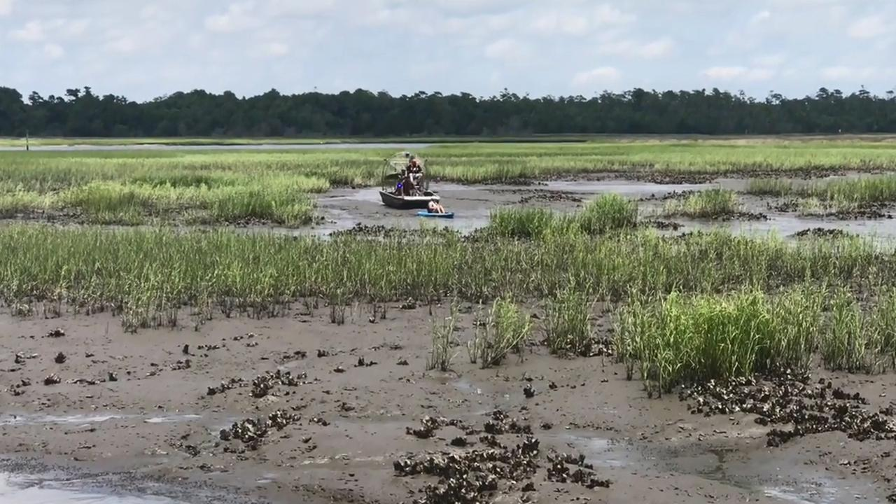 Two kayakers rescued in oyster beds in Oak Island