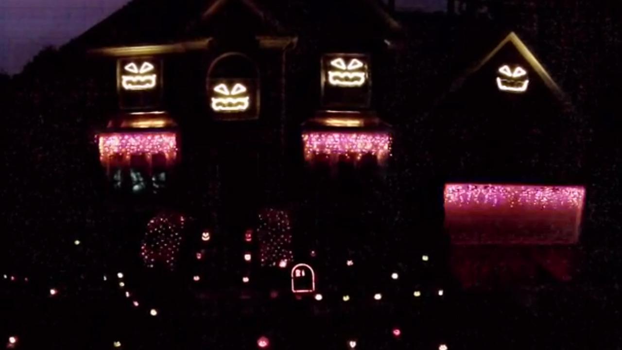 cary familys singing halloween light display